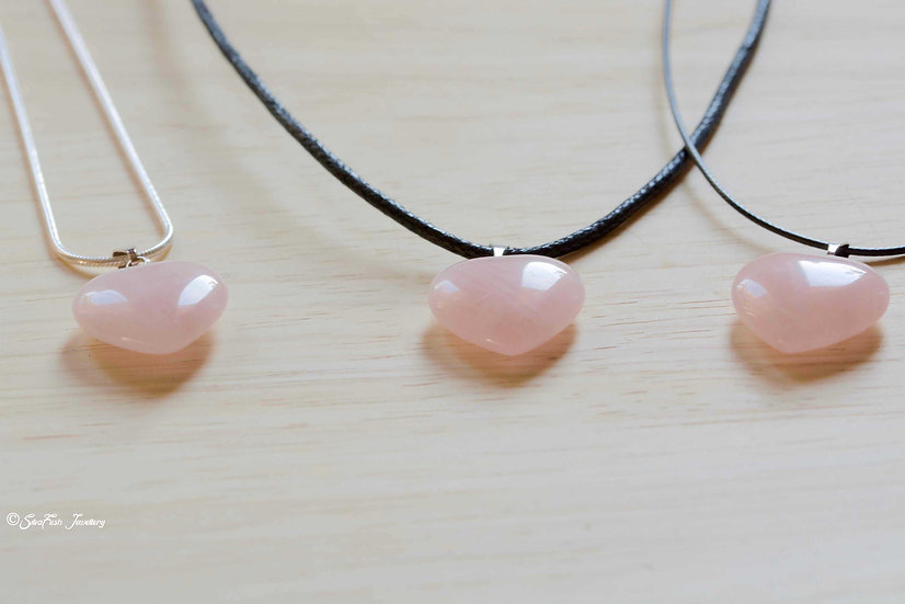 Rose Quartz Heart pendant suspended from sterling silver snake chain or black wax cotton