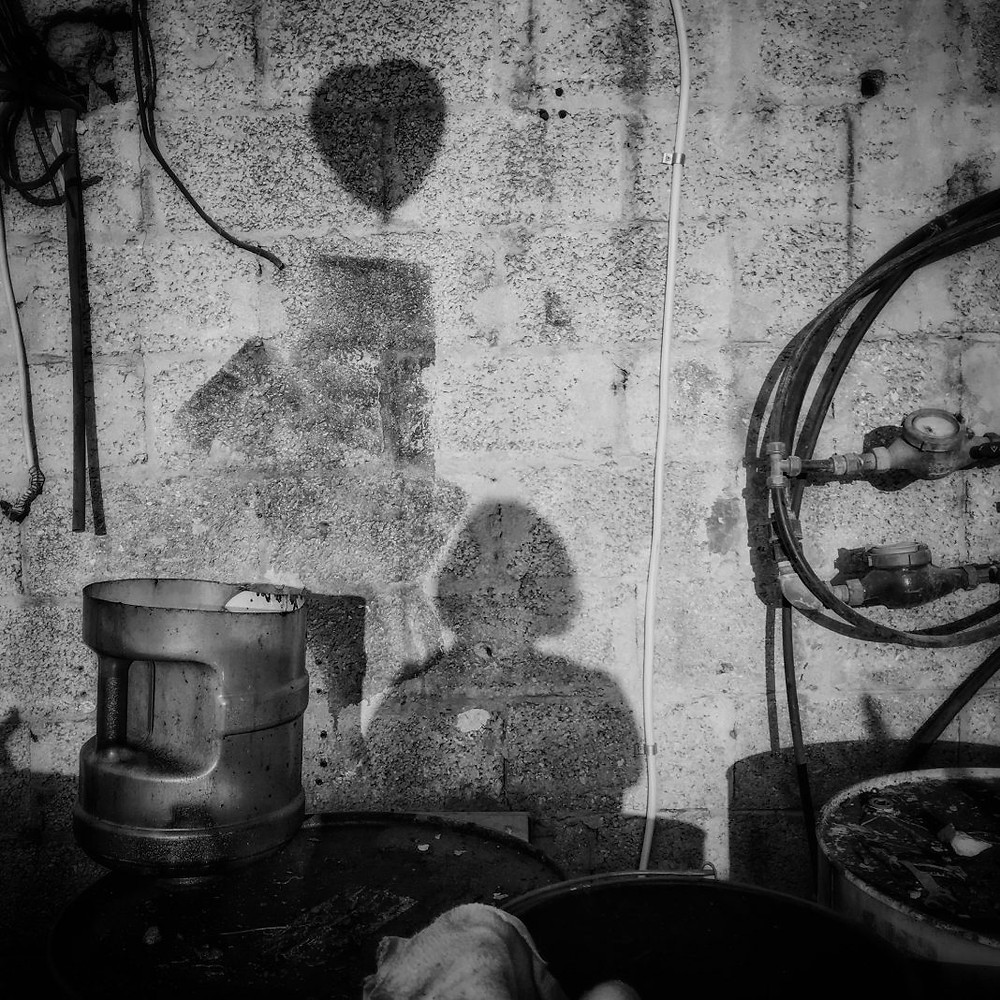 Girl and shadow of a heart shaped balloon