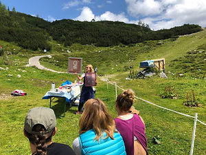 Zimzala hosting a screen printing workshop outside in the mountains