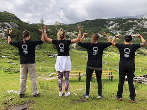 Four women posing with She Dares logo t-shirts on and showing how strong they are
