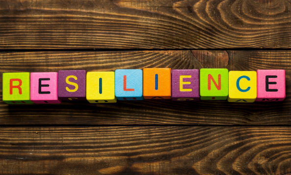 "different colored blocks to spell out ""resilience"""