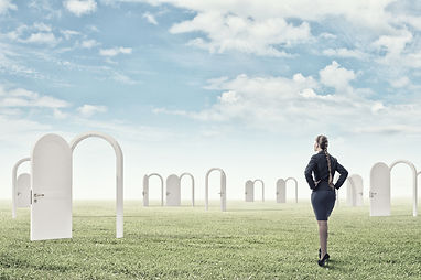 Businesswoman standing in front of opene