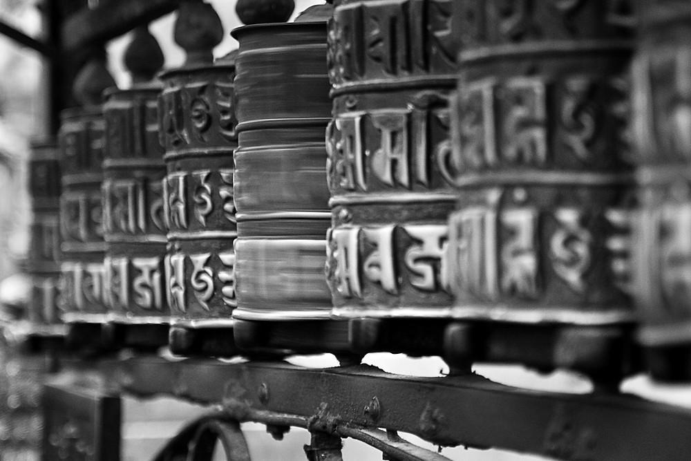 Spinning prayer wheels in Nepal.