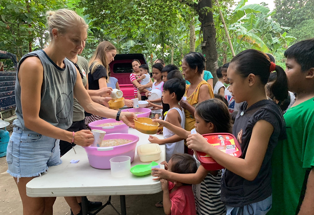 serving dinner at the Rise Above Foundation in Cebu, Philipines