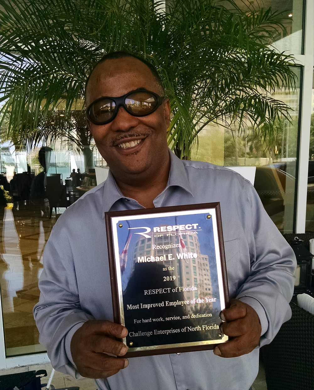 Picture of Michael White with award