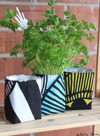Planters for herbs made from used coffee packages and fabric. Idea by eilen tein blog.