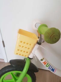 Old cutlery holder works as an adorable basket for this child's bike.
