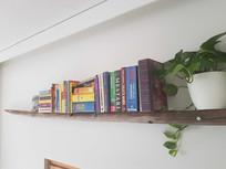 Fence post turned into a book shelf.
