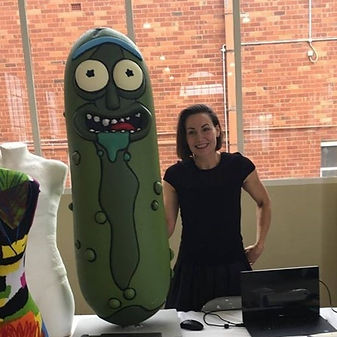 Hollie Bell with giant Pickle Rick