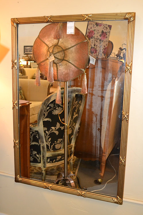 Vintage gold decorative mirror with x-ribbon detail