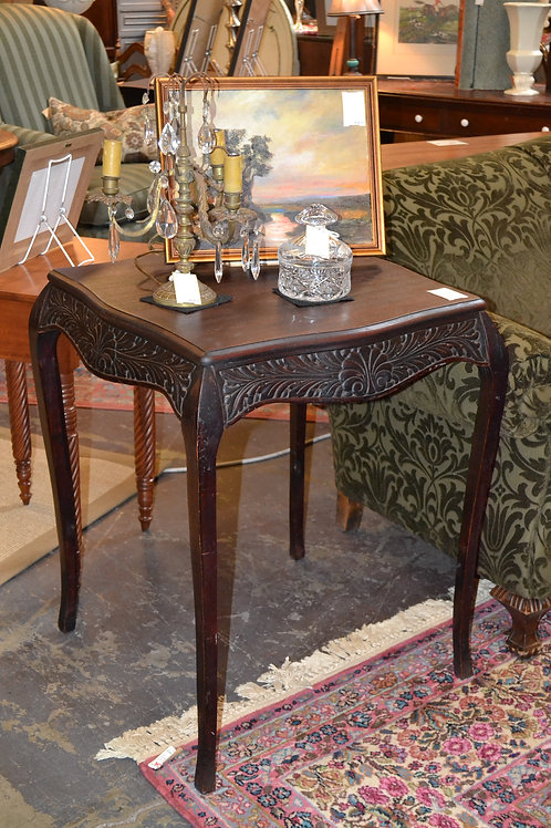 Tall elegantly carved side table