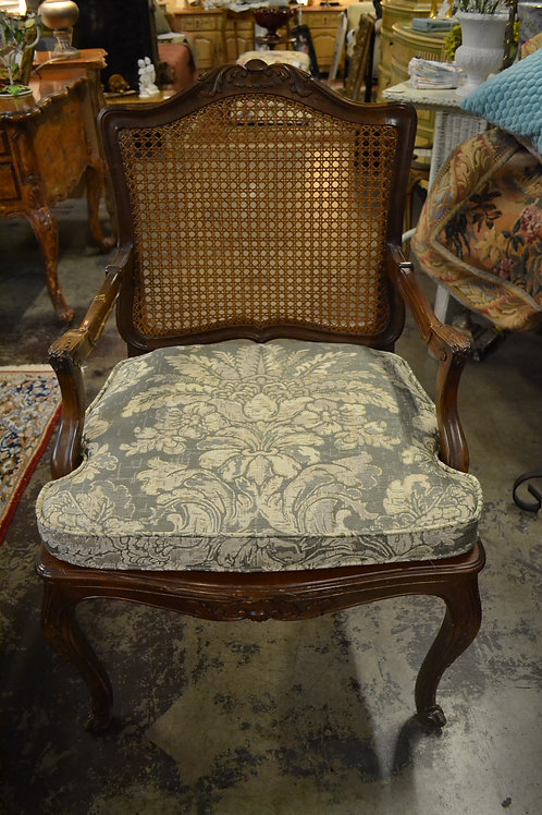Trouvailles French carved arm chair