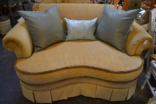 Immaculate curved French style skirted loveseat