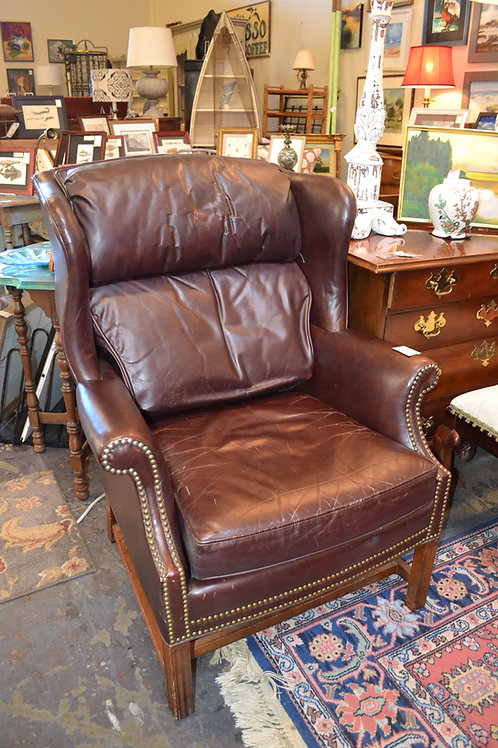 DISTRESSED ENGLISH NAILHEAD LEATHER WING CHAIR