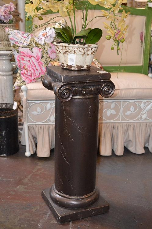 Dark Roman column pedestal