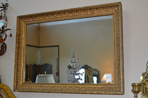 Large vintage gold mirror in concave frame