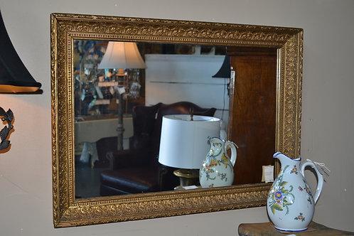 Antique mirror in acanthus frame