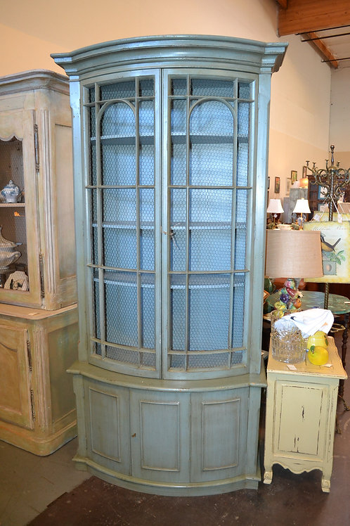 Tall painted teal bow front cabinet with grated wire