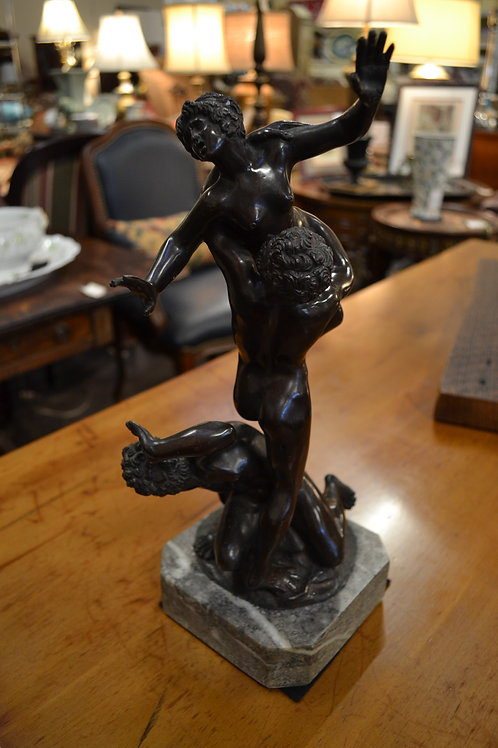 Bronze two men, one holding woman on marble base