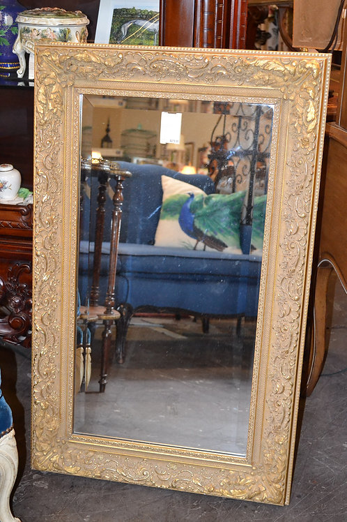 Tall, heavy gold mirror with beveled glass