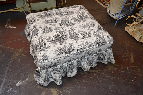 Black, white toile skirted ottoman
