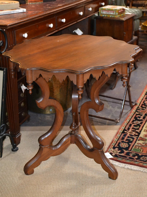 Antique parlor table with scalloped trim