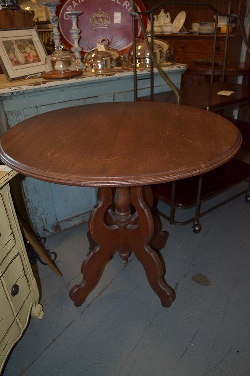 Large round hardwood side table