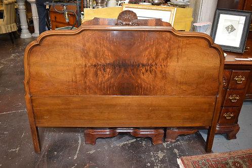 Antique feathered walnut headboard