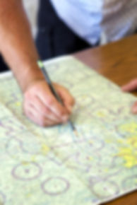 pilot with navigational vfr chart, instructor