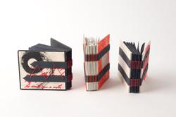3 small tacketed bindings