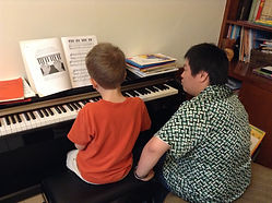 Yosia Elim Teaching Music Temple Piano Student