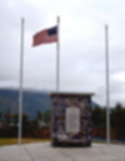 World War II monument in Whittier Alaska with 48 star flag