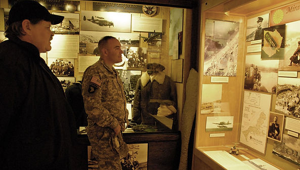 Ted Spencer meeting with a member of the military at the Prince William Sound Muesum in Whittier Alaska