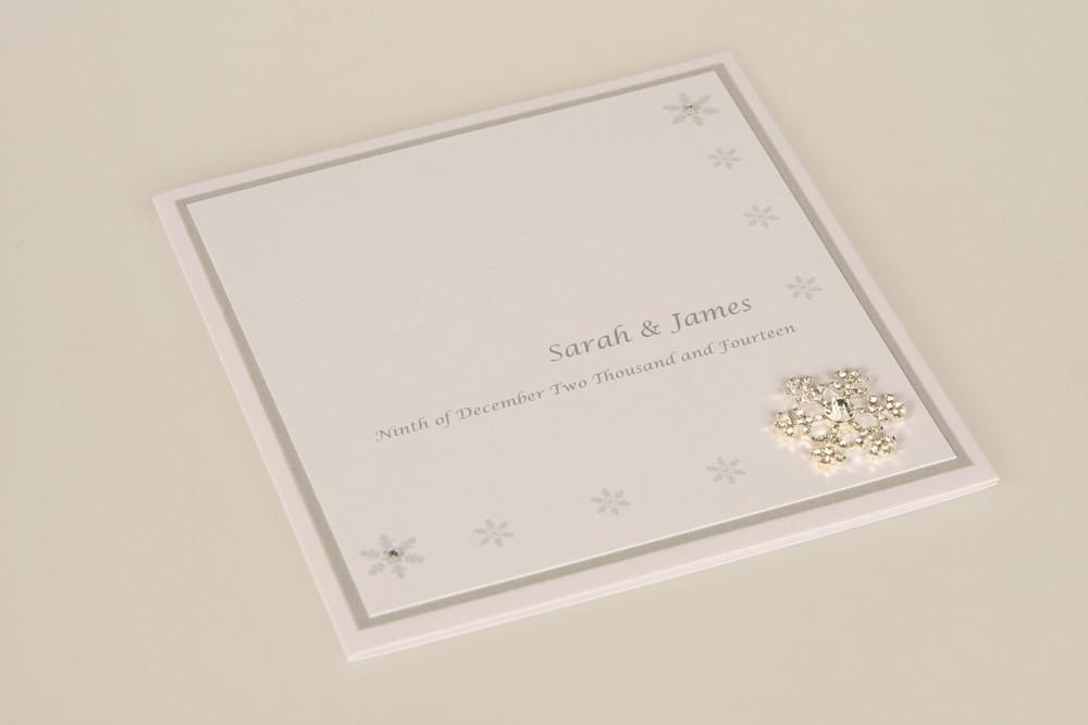 Winter inspired wedding invitation with snowflakes print and snowflake diamante embellishment
