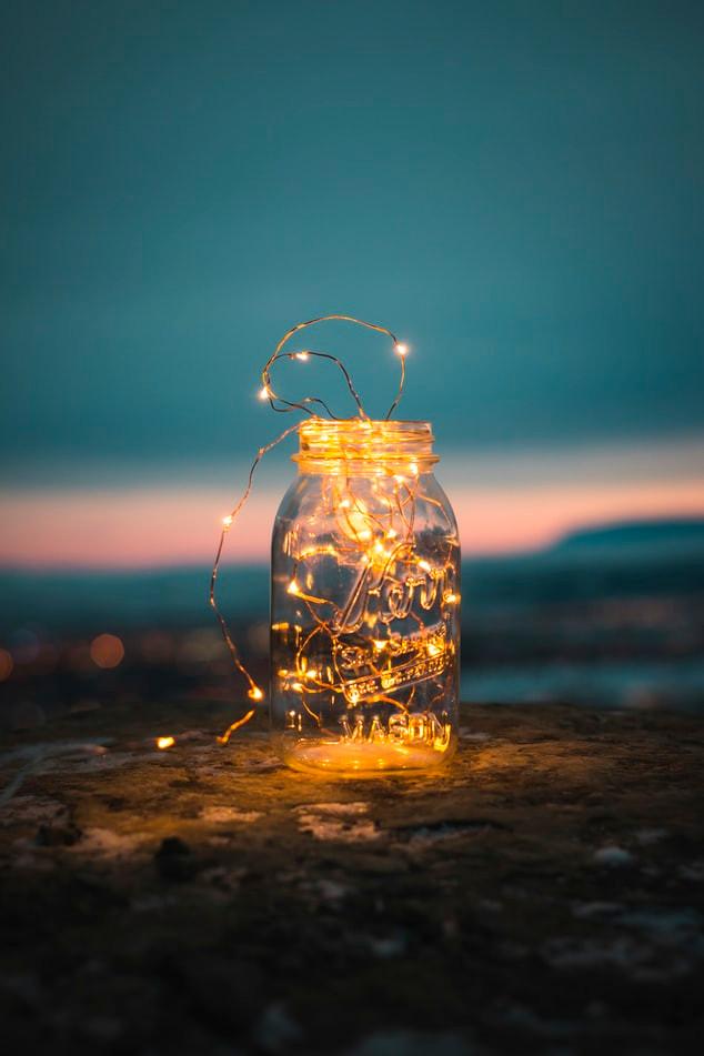 Jar filled with fairy lights, by Steve at Unsplash