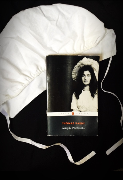 'Tess of the D'Urbervilles', Thomas Hardy Book with Bonnet on Black Background