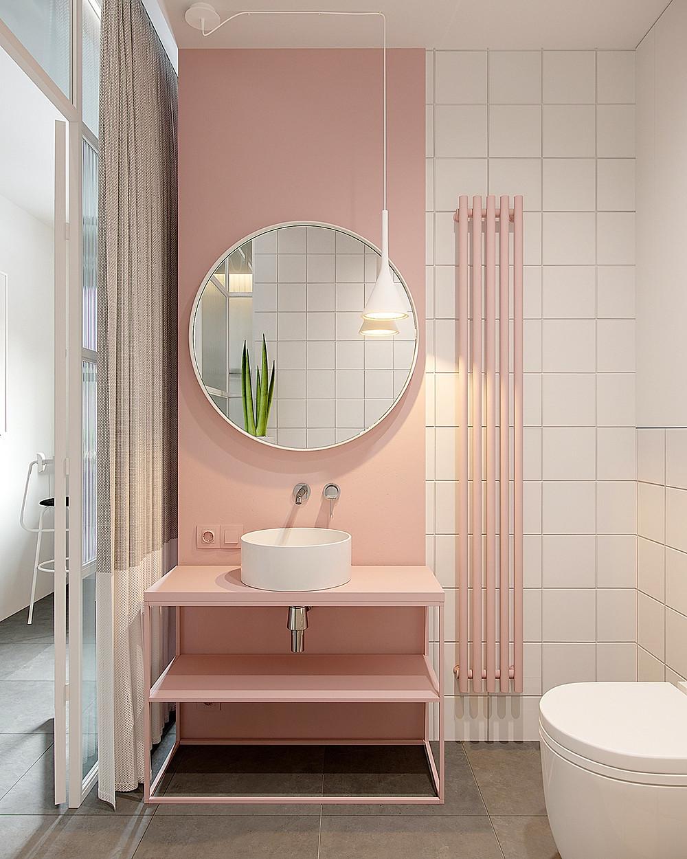 Baño con tonos rosa pastel