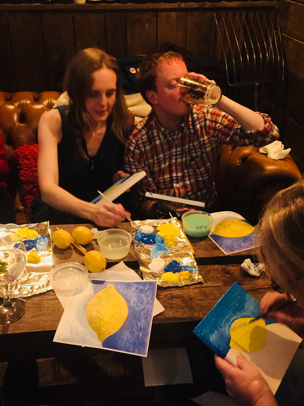 Painting lemons drinking beer at art club in the pub
