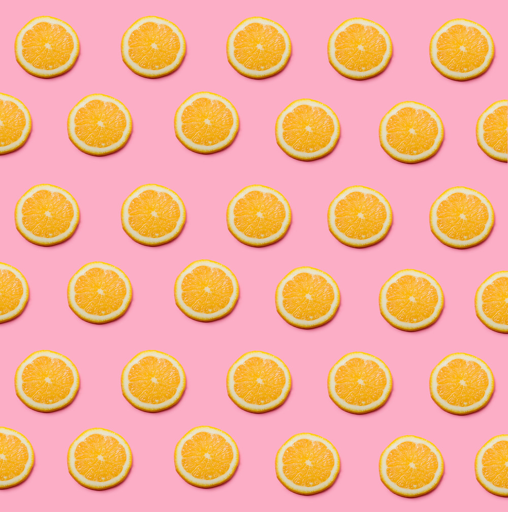 Orange slices on a pink background