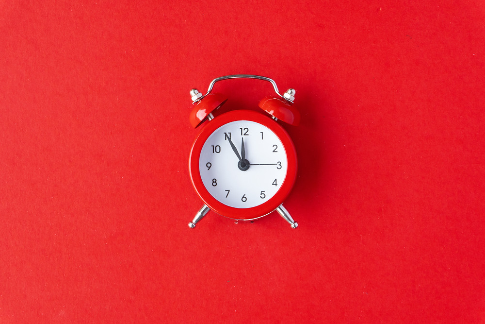A clock showing that a woman's period is late.
