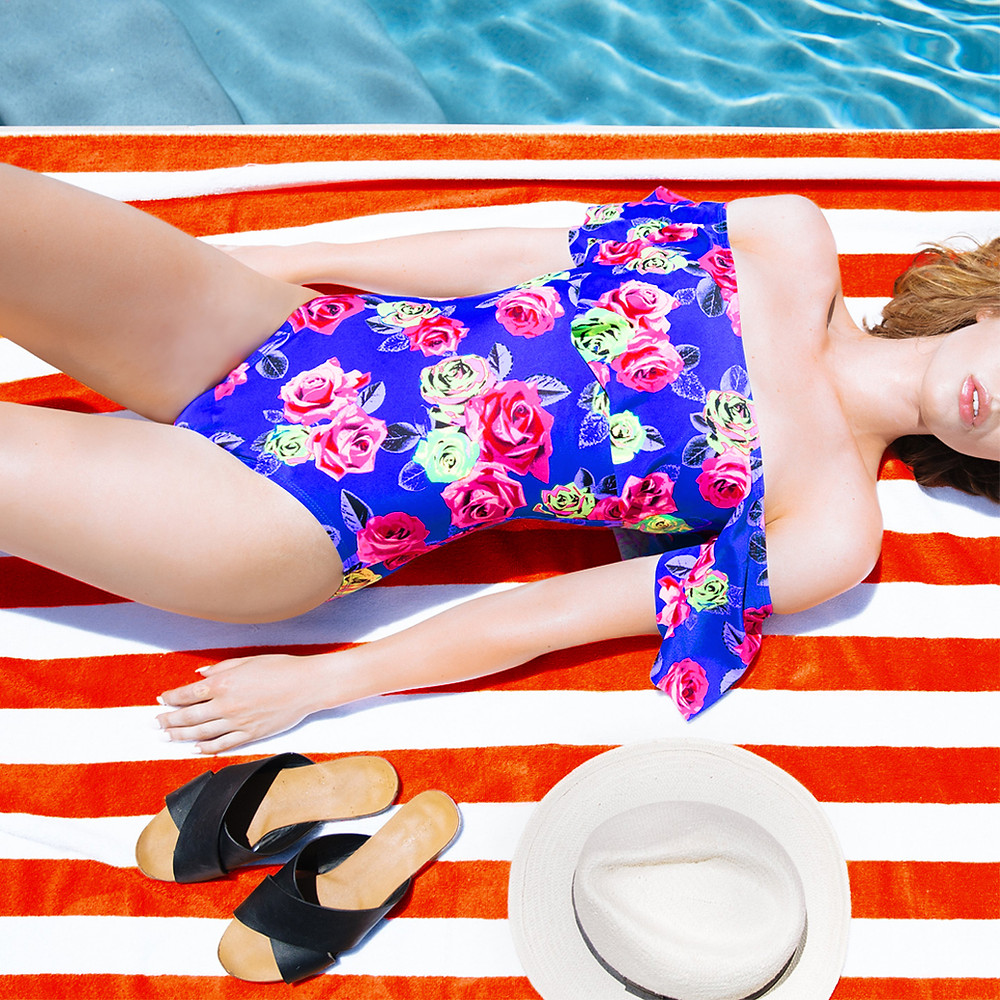 Woman laying out in her Ruby Love Swimwear