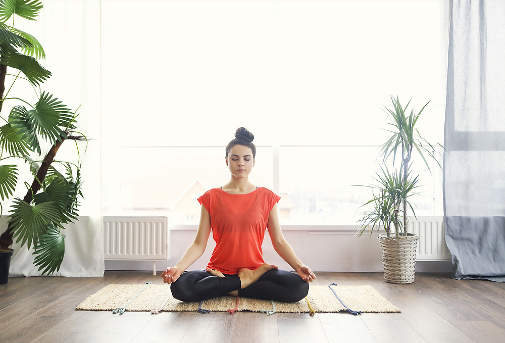 Woman doing yoga to help her period cramps