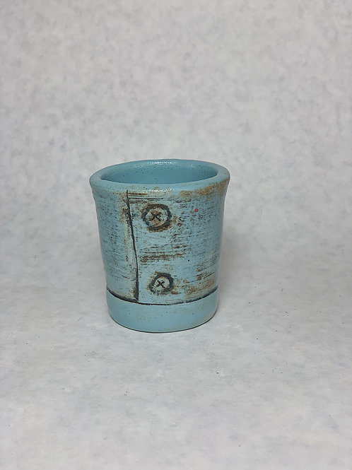 Buttons the shot glass