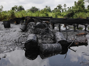 How illegal oil mining destroying Niger delta so much that sand on banks is black in color