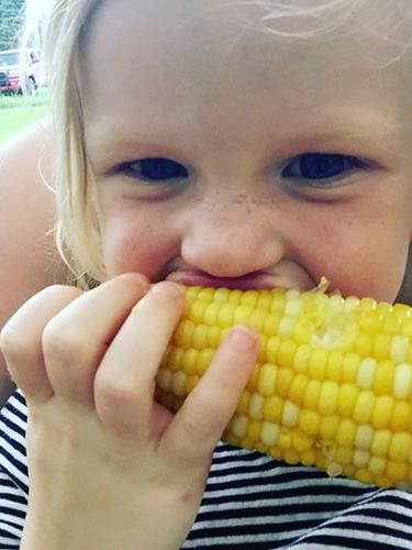 A local family enjoying Iowa Grown sweet corn!