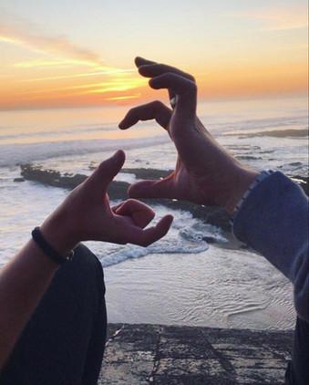 CEMS hands beach.jpeg