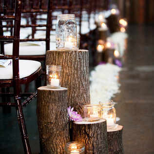 Ceremony tree trunks with candles