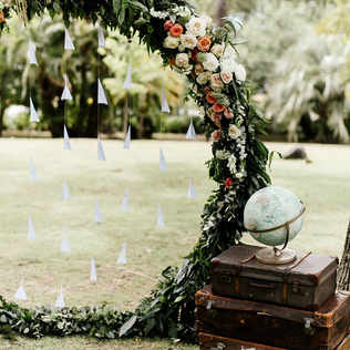 Round floral arch with paper airplane decor