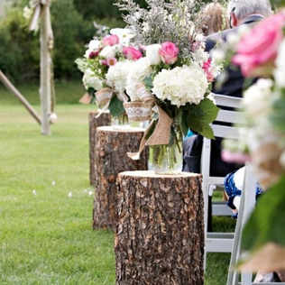 Ceremony tree trunks with flowers