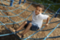 Young boy playing at a park.jpg